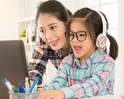 Remote learning student with parent